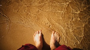 Photograph of feet in sand