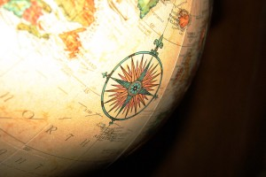 Photo of a globe with a compass